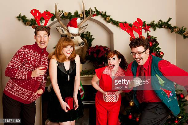 People in festive clothing smiling during a holiday party