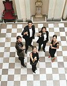 People in formal attire, raising glasses, portrait, elevated view