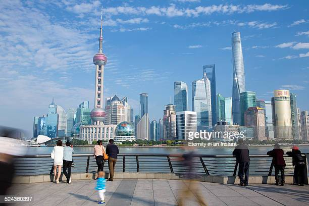 People in front of Shanghai skyline, China
