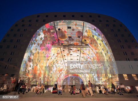 People in front of the Markthal, Rotterdam at dusk