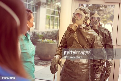 People in hazmat suits entering office for contagious outbreak