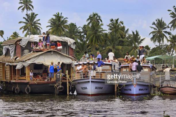 People in houseboat watching Snake boats Racing in Punnamada Lake at Alleppey, Kerala, India