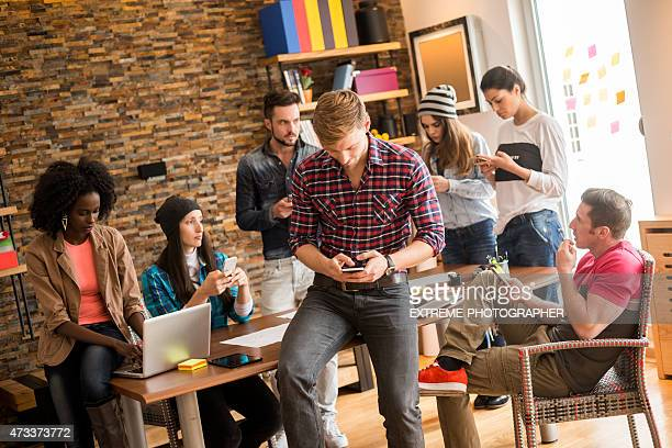 People in IT office with digital devices