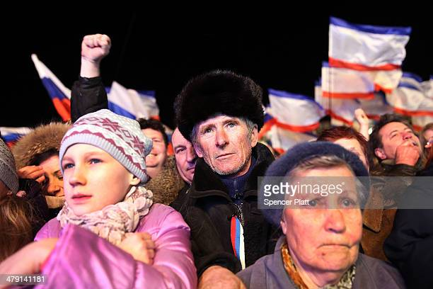 People in Lenin Square attend a pro Russian rally after a day of voting on March 16 2014 in Simferopol Ukraine Crimean's went to the polls today in a...