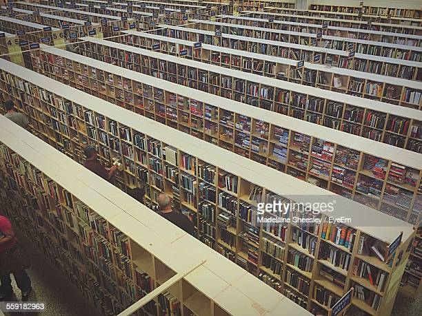People In Library Looking For Books