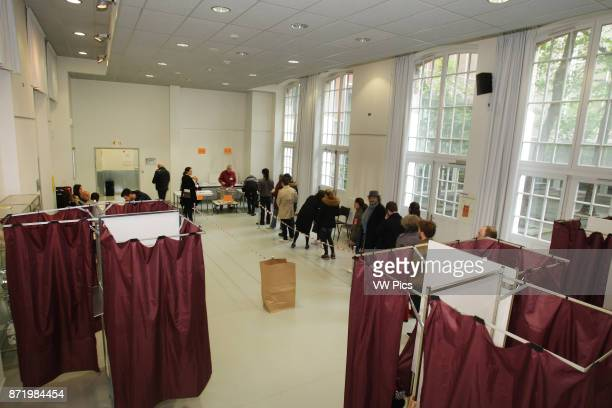 People in line to vote in the 18th district of Paris as French voters go to the polls to vote in the second round of the French Presidential Election...