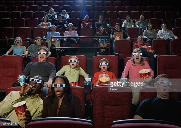 People in Movie Theater Reacting to 3-D Movie