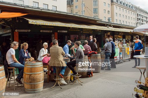 People in outdoor cafe in area of Naschmarkt, Vienna : Stock Photo