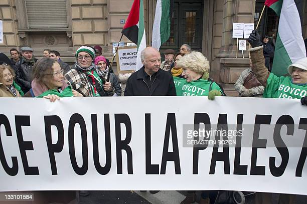 People in particular former bishop Jacques Maillot demonstrate on November 17 2011 in support of 12 proPalestinian activists charged with 'inciting...