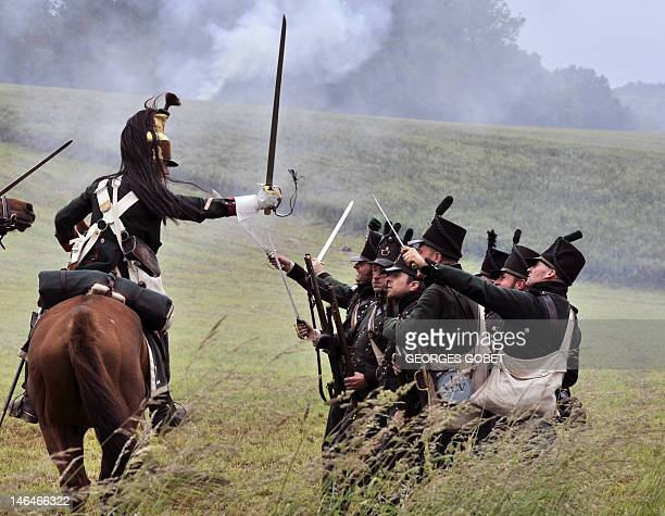 People in period uniforms fight during a reenactment of the 1815 Battle of Waterloo between the French army led by Napoleon and the Allied armies led...