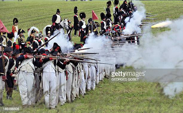 People in period uniforms reenact the 1815Battle of Waterloo between the French army led by Napoleon and the Allied armies led by the Duke of...