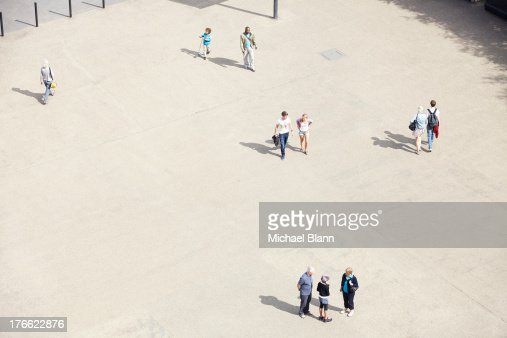 people in plazza seen from above, aerial