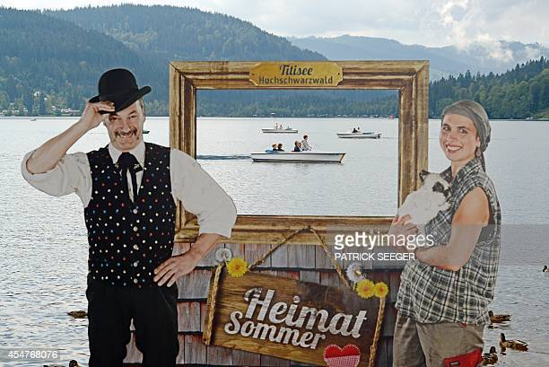 People in pleasure boats making their way over the Titisee lake are seen through a touristic photo frame on September 6 2014 near TitiseeNeustadt...