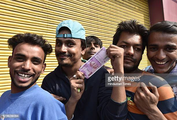 People in queue outside a bank to deposit and exchange 500 and 1000 currency notes at Paharganj on November 16 2016 in New Delhi India Bank started...