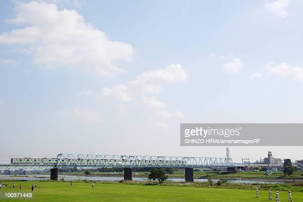 People in riverbank, Tokyo prefecture, Japan