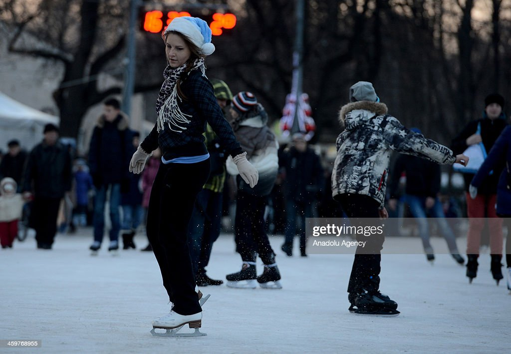 People in Russia ice skate December 29 at a Moscow park decorated with Christmas ornaments, in Moscow, Russia.