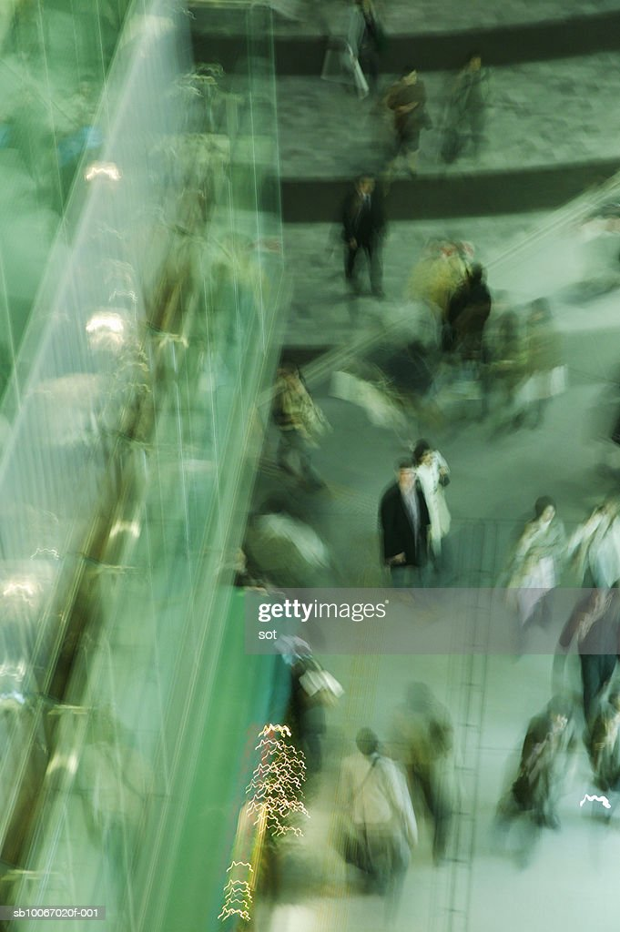 People in shopping mall, elevated view (blurred motion) : Stock Photo