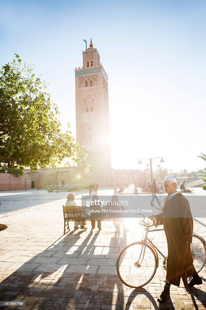 People in square in front of the Koutoubia mosque at sunset, Marrakesh, Morocco