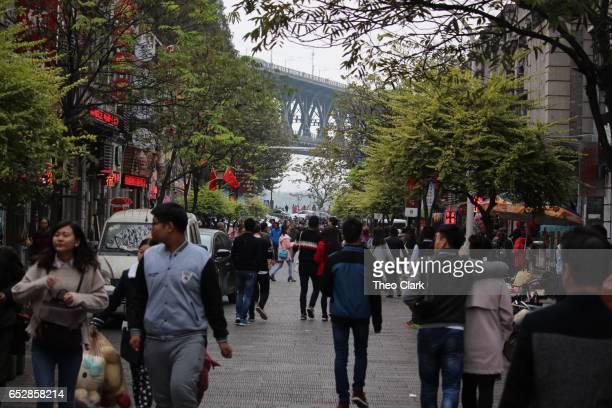 People in street looking to Changjiang Bridge in Wuhan, China