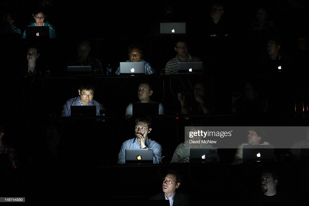 People in the audience are illuminated by the screens of their laptop computers during the Sony press conference on the eve of the Electronic Entertainment Expo (E3) on June 4, 2012 in Los Angeles, California. E3 is the most important yearly trade show the USD 78.5 billion videogame industry.