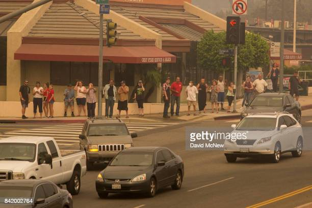 People in the community of Tujunga watch approaching flames during the La Tuna Fire on September 2 2017 near Burbank California Los Angeles Mayor...