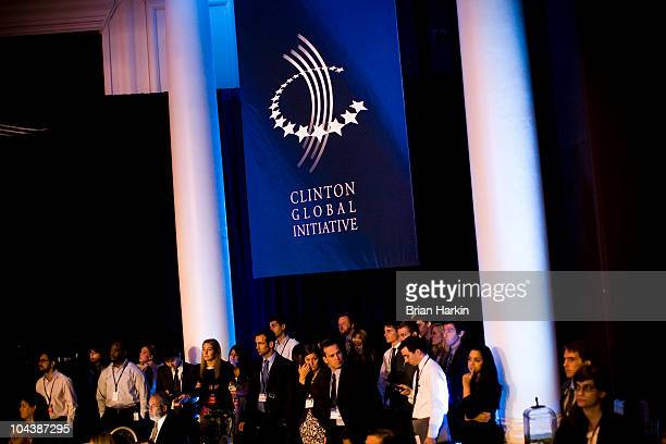 People in the corner of the Metropolitan Ballroom of the Sheraton New York Hotel watch Bill Gates cochair and trustee of the Bill and Melinda Gates...