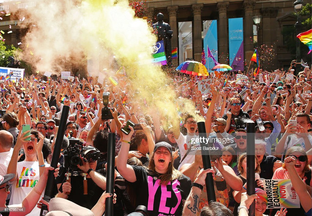 People in the crowd celebrate as the result is announced during the Official Melbourne Postal Survey Result Announcement at the State Library of Victoria on November 15, 2017 in Melbourne, Australia. Australians have voted for marriage laws to be changed to allow same-sex marriage, with the Yes vote defeating No. Despite the Yes victory, the outcome of Australian Marriage Law Postal Survey is not binding, and the process to change current laws will move to the Australian Parliament in Canberra.