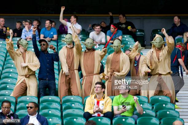 People in the crowd dressed as 'Yoda' from Star Wars are pictured dancing at the London Sevens rugby union event part of the IRB Sevens World Series...