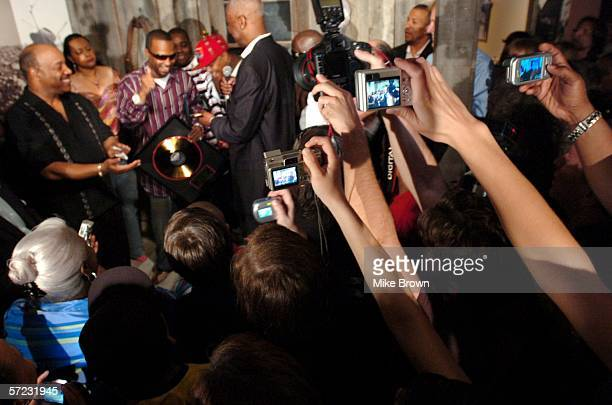 People in the crowd try to get a picture as Memphis Mayor WW Herenton salutes the Academy Award winning rap group Three 6 Mafia on Saturday April 1...