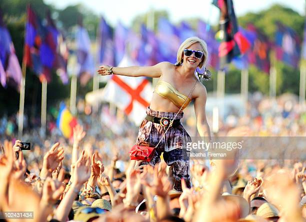 People in the festival crowd enjoy watching Dizzee Rascal on the Pyramid stage during day two of the Glastonbury Festival at Worthy Farm on June 25...
