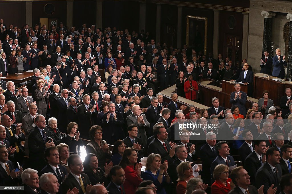 People in the gallery applaud for US Army Ranger Sergeant First Class Cory Remsburg as he is acknowledged by U.S. President Barack Obama during the State of the Union address to a joint session of Congress in the House Chamber at the U.S. Capitol on January 28, 2014 in Washington, DC. In his fifth State of the Union address, Obama is expected to emphasize on healthcare, economic fairness and new initiatives designed to stimulate the U.S. economy with bipartisan cooperation.