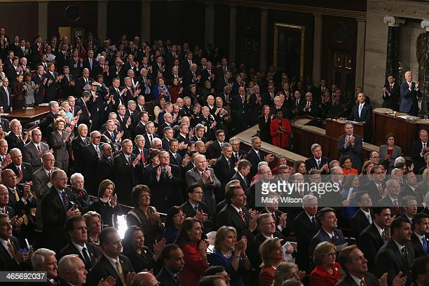 People in the gallery applaud for US Army Ranger Sergeant First Class Cory Remsburg as he is acknowledged by US President Barack Obama during the...