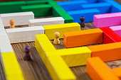 People in the maze, finding a way out. The man in the maze. The concept of a business strategy, analytics, search for solutions, the search output. Labyrinth of colorful wooden blocks, tetris.