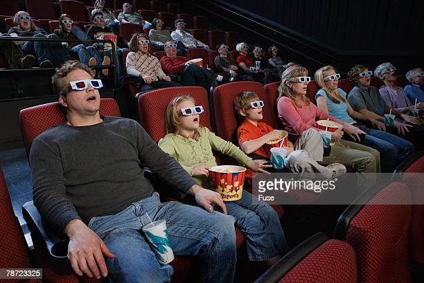 People in Theater Watching 3-D Movie