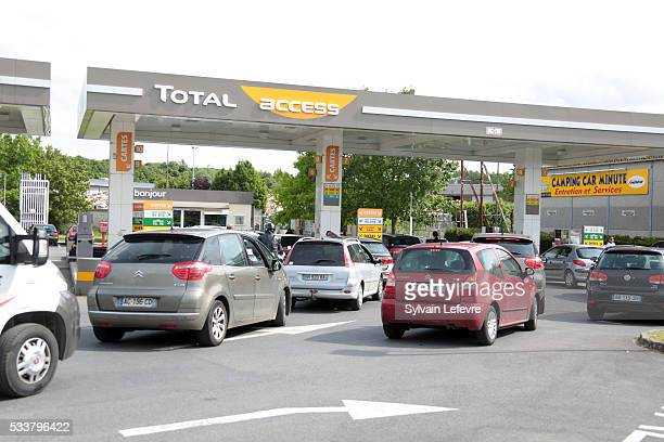 People in their car queue on line at a gas station following the blockades of several oil depots by protesters opposed to the government's proposed...