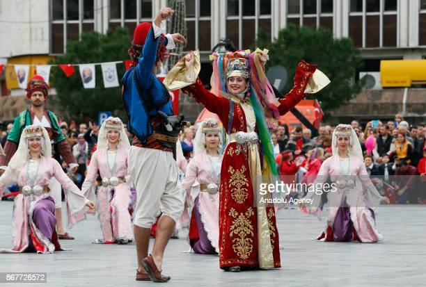 People in traditional clothes perform during the celebrations for the 94th Anniversary of Republic Day at the Izmir Cumhuriyet Square in Izmir Turkey...