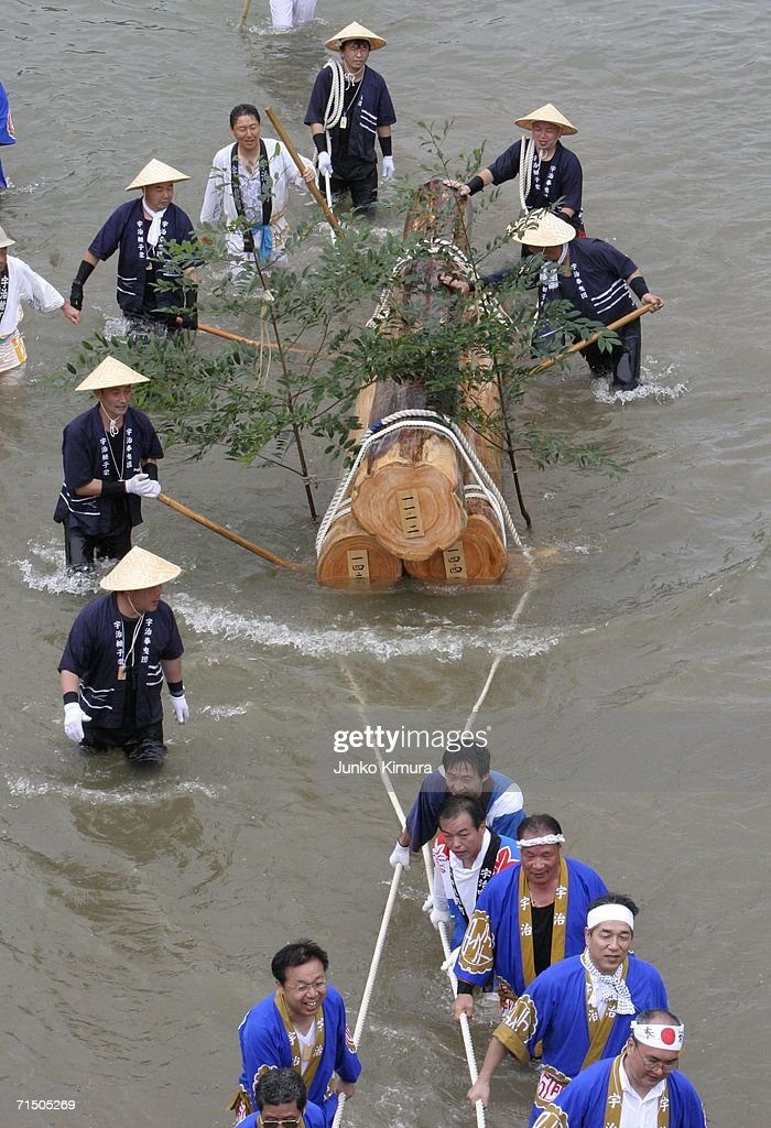 People in traditional dress pull wood along the Isuzu River to the Inner Shrine of Japan's biggest shrine ?Ise Jingu? during the 62nd Okihiki-Gyoji ceremony on July 23, 2006 in Ise, Mie Prefecture, Japan. The Okihiki-Gyoji ceremony is conducted every 20 years for the last 1300 years and involves the shrines of Ise Jingu being moved and reconstructed and is called the Sengu, it is believed that by performing the Sengu the Japanese people will have their blessings renewed.