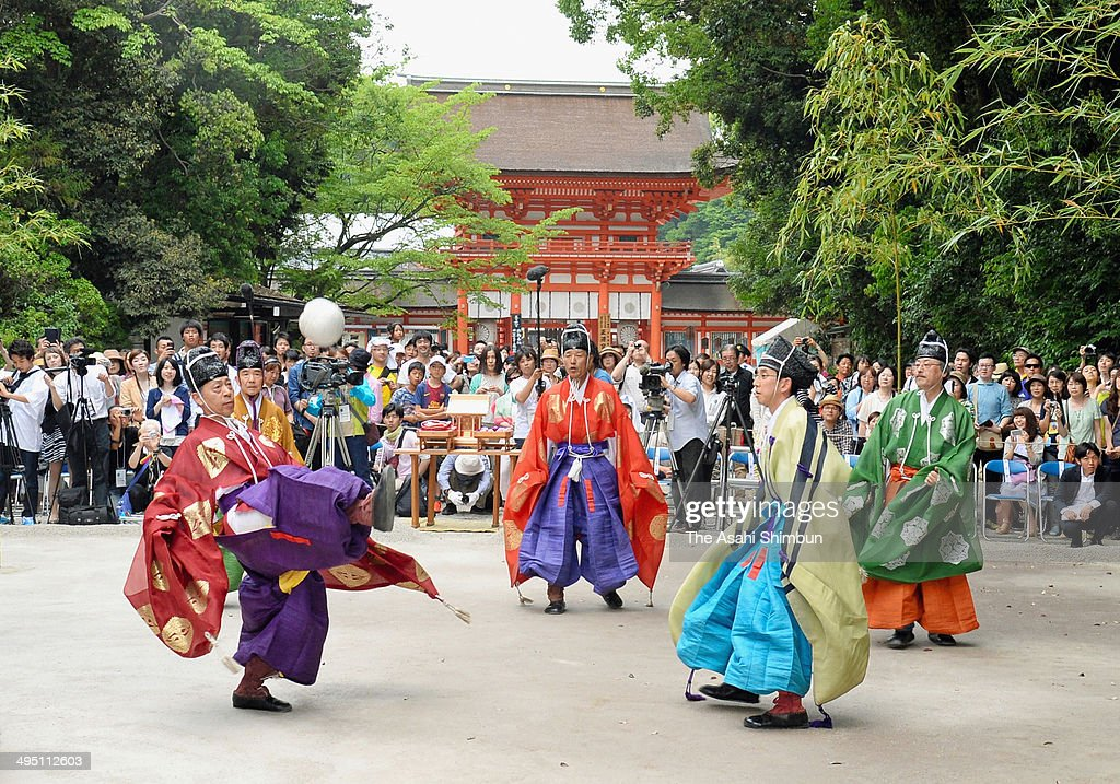 People in traditional Heian era costumes keep the ball in the air during the Kemari, traditional game at Shimogamo Shrine on May 31, 2014 in Kyoto, Japan. The game was dedicated in pray for Japan's victory during the World Cup in Brazil.