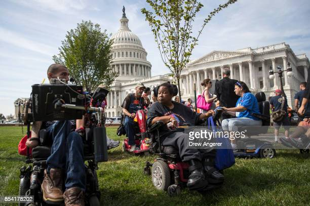 People in wheelchairs from the group ADAPT wait for senators to arrive for a news conference in opposition to the GrahamCassidy health care bill...