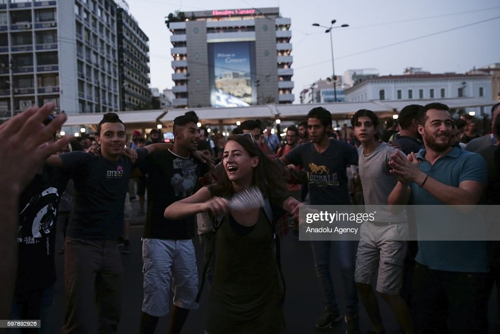 People including refugees attend a demonstration to support the refugees by the call of Leftist groups in Athens Greece on August 29 2016