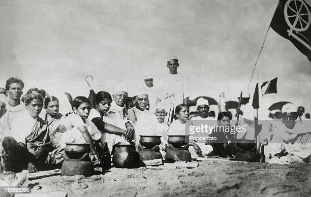 circa 1930 Followers of Gandhi deliberately breaking the law by evaporating salt from seawater This demonstration occurred at the time when the Salt...