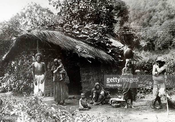 circa 1930's A family of Untouchables outside their home near Bombay showing the poor conditions in which they have to live