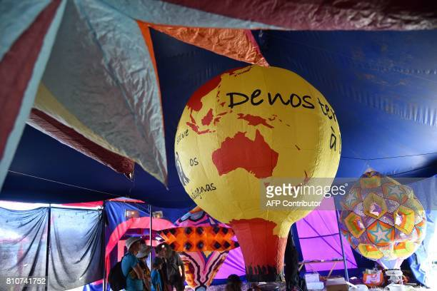 People inflate air balloons during a twoday meeting organised by opponents to a controversial international airport project in the area on July 8 in...