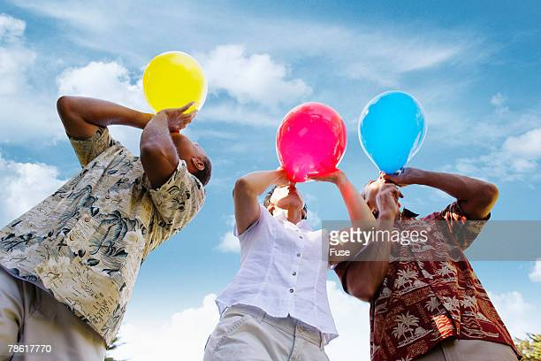People Inflating Party Balloons