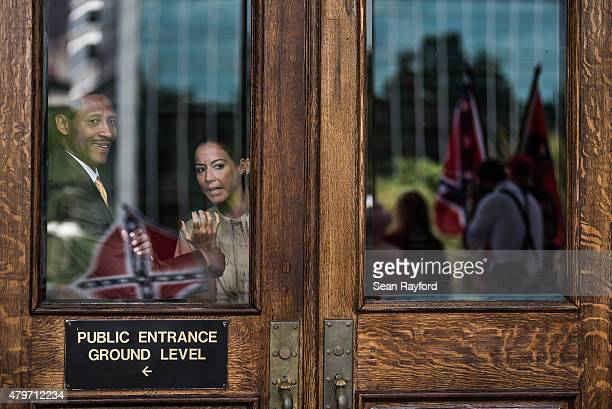 People inside the capitol building watch as Confederate flag supporters gather at the state house July 6 2015 in Columbia South Carolina The state...