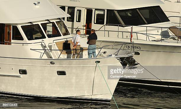 People inspect a vessel at the Sydney International Boat Show at Darling Harbour on July 30 2009 in Sydney Australia A wharf with 190 vessels moored...