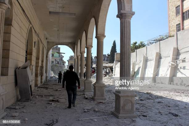 People inspect the area after Russian warcrafts allegedly carried out airstrikes at Ravda Mosque and market in Salkin town of Idlib Syria on April 4...