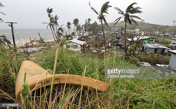 People inspect the damage at Namuimada village settlement on February 26 caused by Cyclone Winston which devastated Fiji Humanitarian aid was finally...