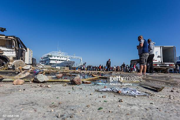 People inspect the damaged area after the clashes between a group of demonstrators protesting against oil tankers try to reach Petrofac Oil company's...