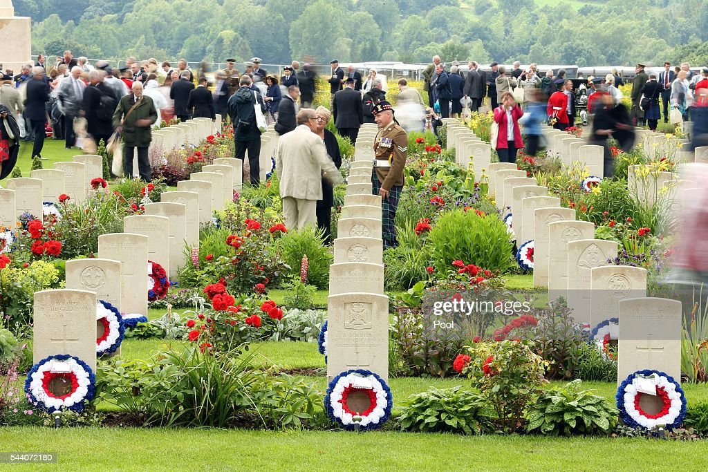 People inspect the headstones after a service to mark the 100th anniversary of the start of the battle of the Somme at the Commonwealth War Graves Commission Memorial on July 1, 2016 in Thiepval, France. The event is part of the Commemoration of the Centenary of the Battle of the Somme at the Commonwealth War Graves Commission Thiepval Memorial in Thiepval, France, where 70,000 British and Commonwealth soldiers with no known grave are commemorated.